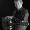 Jim Curry BW -with Guitar